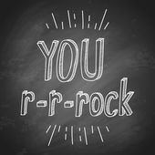 Slogan you rock on chalkboard — Stock vektor