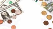 Euro and dollars lay opposing over white and the silhouettes of — Stock Photo