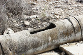 Aged and cracked concrete pipe for watering. — Stock Photo