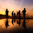 Silhouette cyclists with reflection — Stock Photo #67757909
