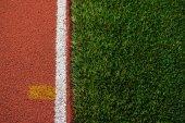 Artificial grass and run track texture — Stockfoto