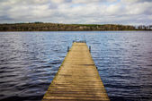 Jetty, wooden pier in daylight — Stock Photo