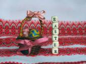 Easter eggs and letters of beads — Stock Photo