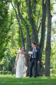Just married couple walking in the woods — Stock Photo