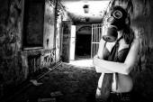 Girl in gas mask in abandoned building — Stock Photo