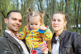 Happy parents with daughter outdoor — Stock Photo