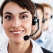 Three call center service operators at work — Stock Photo #76009967