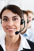 Three call center service operators at work — Stock Photo