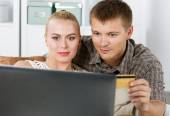 Family couple making shopping over internet — Stock Photo