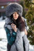 Beautiful young girl in a fur hat — Photo