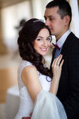 The groom kisses the bride in her head — Stock Photo