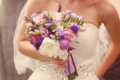 Wedding bouquet in the hands of a bride — Stock Photo