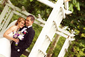 Bride and groom in springtime — Stock Photo