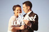 Bride and groom on their wedding day — Stock Photo