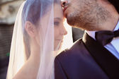 Close up of a bride and groom in the sunlight — Stock Photo
