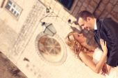 Bride and groom in old city — Stock Photo