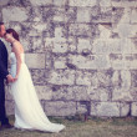 Bride and groom kissing near brick wall — Stock Photo #74205899