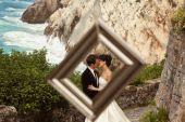 Happy bridal couple near seaside — Stock Photo