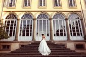 Elegant bride walking up on a set of stairs — Stock Photo