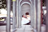 Bride and groom sitting in the city — Stock Photo