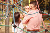 Playful parents with their baby girl in the park — Foto de Stock