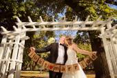 Couple holding Just Married signs — Stock Photo