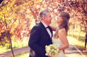 Bride and groom on a autumn day — Stock Photo
