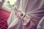 Beautiful ribbon on wedding chair — Stock Photo