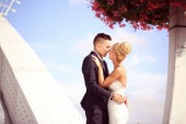Bride and groom on a metallic bridge — Stock Photo