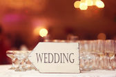 Wedding sign near many galsses of champagne — Stock Photo