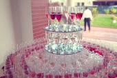 Big rounded glass with many galsses of wine — Stock Photo