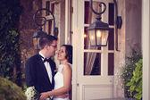 Bride and groom near door with windows — Stock Photo