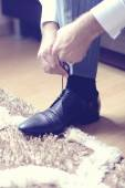 Groom putting his shoe on — Stock Photo