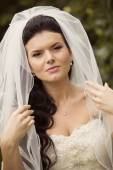 Portrait of beautiful bride with veil — Stock Photo