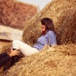 Couple on a hay bale — Stock Photo #74719129