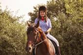 Beautiful woman with her horse — Stock Photo