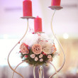 Candle and flower stand on wedding table — Stock Photo #74732633