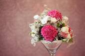 Mix of flowers in a vase — Stock Photo