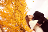 Bride and groom on autumn day — Stock Photo
