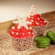 Red cupcakes and green macaroons — Stock Photo #74893027