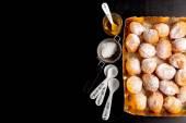 Donuts in a glass vase, powdered sugar and honey — Stock Photo