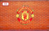 MANCHESTER, ENGLAND - FEBRUARY 17, 2014: Logo on the home team player zone in the Old Trafford stadium on February 17 ,2014 in Manchester, England. Old Trafford stadium is home to Manchester United. — Stock Photo