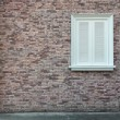 Background of vintage brick wall texture and white window — Stock Photo #75219989