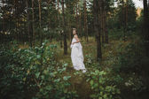 Beautiful girl in a white dress fairy in the woods — Stock Photo