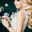 Young pretty woman with beautiful blond hairs — Stock Photo #68566221
