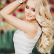 Young pretty woman with beautiful blond hairs — Stock Photo #68566225