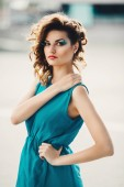 Portrait of a beautiful girl in a turquoise dress — Stock Photo