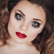 Portrait of elegant beautiful girl with red lips in black dress with unusual eyelashes — Stock Photo #68588101