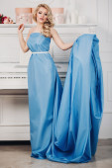 Beautiful girl in a blue long dress — Stock Photo