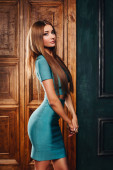 Beautiful slim sexy girl with long hair in blue dress — Stock Photo